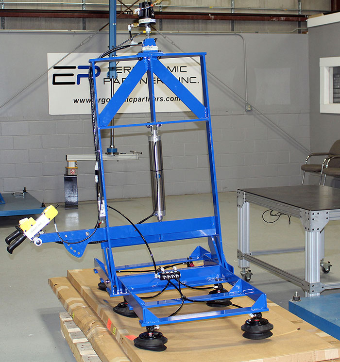 Grip and Rotate Vacuum Lifter for Flexible Boxes